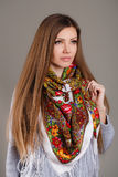 Portrait of a beautiful young woman with a scarf. Beautiful oriental look. portrait of a beautiful young woman with a scarf. Russian beauty. Russian national Royalty Free Stock Photo