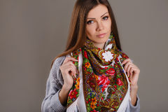 Portrait of a beautiful young woman with a scarf. Royalty Free Stock Photo