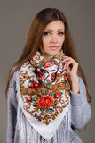 Portrait of a beautiful young woman with a scarf. Stock Photography