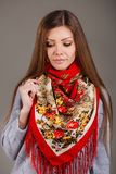 Portrait of a beautiful young woman with a scarf. Beautiful oriental look. portrait of a beautiful young woman with a scarf. Russian beauty. Russian national Royalty Free Stock Images