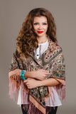 Portrait of a beautiful young woman with a scarf. Royalty Free Stock Images