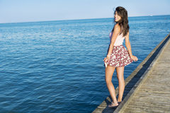 Portrait of beautiful young woman on a sea background Royalty Free Stock Photos