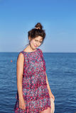 Portrait of beautiful young woman on a sea background Stock Photography