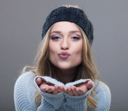Portrait of a beautiful young woman sends a kiss Stock Photography