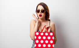 Portrait of beautiful young woman with shopping bag. On the wonderful white studio background Stock Photos