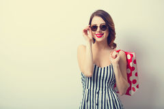 Portrait of beautiful young woman with shopping bag. On the wonderful white studio background Stock Image