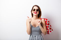Portrait of beautiful young woman with shopping bag. On the wonderful white studio background Royalty Free Stock Photography