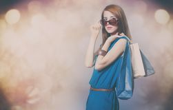 Portrait of beautiful young woman with shopping bags on the wond Royalty Free Stock Photo
