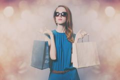 Portrait of beautiful young woman with shopping bags on the wond Stock Photos