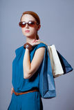 Portrait of beautiful young woman with shopping bags on the wond Royalty Free Stock Images