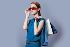 Portrait of beautiful young woman with shopping bags on the wond Royalty Free Stock Photography