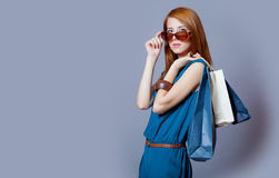 Portrait of beautiful young woman with shopping bags on the wond Stock Photo