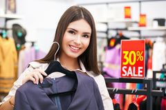 Beautiful woman shopping and looking at some clothing. Stock Photo