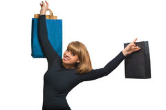 Portrait of a beautiful young woman with shopping. On a white background Royalty Free Stock Photography