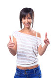 Portrait of a beautiful young woman showing thumbs up sign Royalty Free Stock Photo