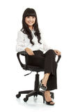 Portrait of beautiful young woman sitting on chair Royalty Free Stock Image