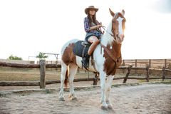 Portrait of beautiful young woman sitting on horse Stock Image