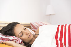 Portrait of the beautiful young woman sleeping in white bed Royalty Free Stock Photos
