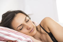 Portrait of the beautiful young woman sleeping in white bed Stock Image