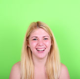 Portrait of beautiful young woman smiling against green backgrou Stock Photography