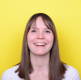 Portrait of beautiful young woman smiling against yellow backgro Stock Photos