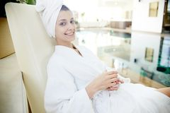Woman Relaxing by Pool in SPA royalty free stock images