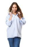 Portrait of a beautiful young woman smiling and holding shirt Royalty Free Stock Photos