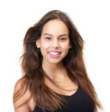 Portrait of a beautiful young woman smiling on isolated white background Royalty Free Stock Image