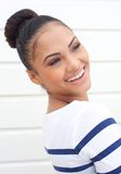Portrait of a beautiful young woman smiling and looking away Royalty Free Stock Image