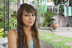 Portrait of beautiful young woman smiling outdoors, Manila, Philippines Royalty Free Stock Photography