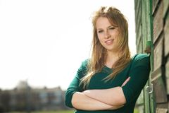 Portrait of a beautiful young woman smiling outside Royalty Free Stock Photography