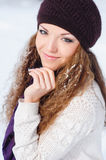 Portrait of a beautiful young woman with snow on her hair Royalty Free Stock Photos