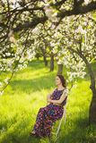 Portrait of beautiful young woman in spring garden royalty free stock image