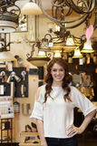 Portrait of beautiful young woman standing in lights store Stock Photography