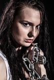 Portrait of a beautiful young woman with a steel chain Stock Photography