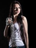Portrait of a beautiful young woman with a steel chain Royalty Free Stock Images