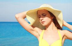 Portrait of beautiful young woman in straw summer hat enjoying Stock Image