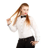 Portrait of beautiful young woman in strict clothing with bow ti Stock Photo