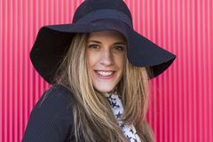 Portrait of a beautiful young woman with a stylish hat, she is s royalty free stock image