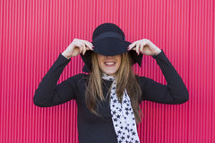 Portrait of a beautiful young woman with a stylish hat, she is s royalty free stock images