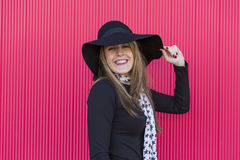 Portrait of a beautiful young woman with a stylish hat, she is s stock photo
