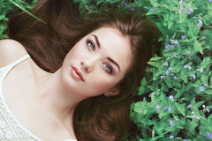 Portrait of a beautiful young woman in summer garden Royalty Free Stock Images