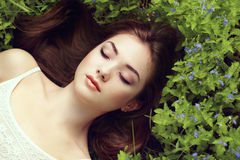 Portrait of a beautiful young woman in summer garden Royalty Free Stock Image