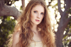 Portrait of a beautiful young woman in summer garden Stock Images