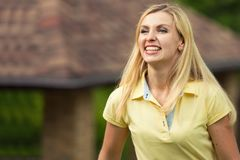 Portrait of a beautiful young woman. Summer walk in the park. royalty free stock photos