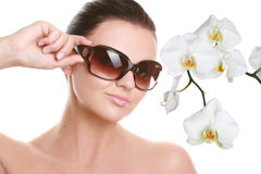 Portrait of a beautiful young woman in sun glasses Stock Image