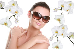 Portrait of a beautiful young woman in sun glasses Stock Photos
