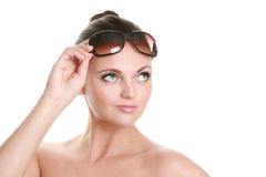 Portrait of a beautiful young woman in sun glasses Royalty Free Stock Image