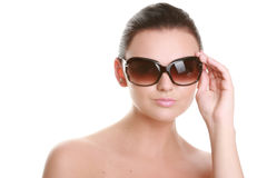 Portrait of a beautiful young woman in sun glasses Stock Photo