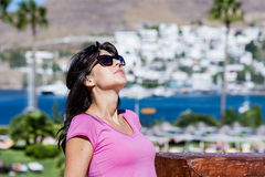 Portrait of beautiful young woman sunbathing outdoor Stock Image